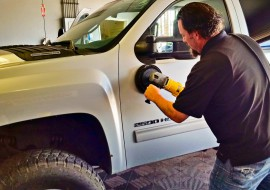 Buffing the surface to a high shine at Executive Car Wash