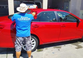 executive-associate-washing-a-red-car